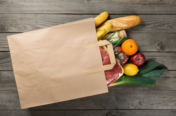Paper bag filled with fresh food from the supermarket