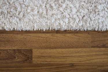 Carpet on a teak wood floor make a perfect floor experience
