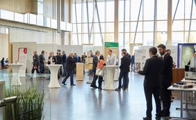 participants in exhibition foyer